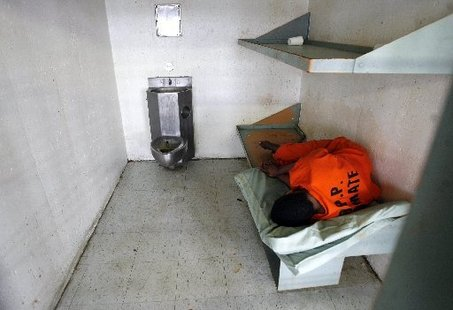 Michael Democker, An inmate sleeps in his cell in the 10th floor psychiatric section of Orleans Parish Prison, 2008