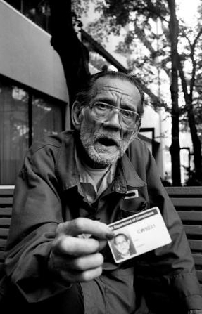 Earl flashes his prison ID photo card when approached. It is all that he has to show for himself. Sarah Bones