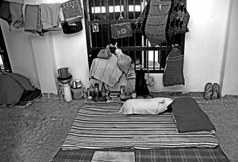 "Cell, Momena Jalil, 2008. Having spent a year in prison already, 25-year-old Rahima still cannot reconcile with her living conditions. ""The air, the walls, the people, the place- all of it has been a shock for me"", she says. She struggles to wear the blank and emotionless expression that the rest of her inmates wear every day, yet every time she speaks of her experience in jail, she fights back tears."