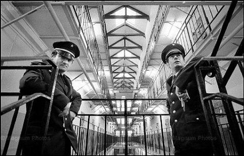 Jean Gaumy, Maison d'arrêt. Caen, France, 1976. Surveillance in the Passageway.