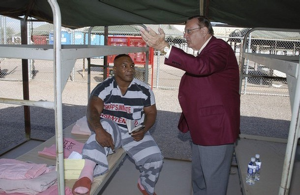 Former world heavyweight boxing ch&ion Mike Tyson listens to Sheriff Joe Arpaio (R) in & Tent City | Prison Photography