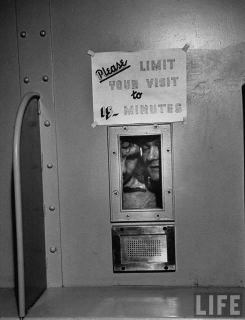Prisoners watching baptism of repentant killer, in Harris County jail, TX, US. March 1954. Credit: John Dominis. ©2008 Google
