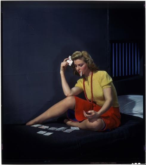 Woman in cell, playing solitaire. ca. 1950. Nickolas Muray. Transparency, chromogenic development (Kodachrome) process. George Eastman House Collection - Accession # 1983:0567:0151