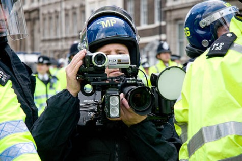 LONDON, UNITED KINGDOM - 15.06.08. A Metropolitan Police Forward Intelligence Team (FIT) photographer films and photographs journalists as police and protesters clash during a demonstration against U.S President George W Bush in Parliament Square, Westminster on Sunday 15 June 2008, London, England. Protesters had been banned by the Metropolitan Police from demonstrating outside 10 Downing Street to protest against the wars in Iraq and Afghanistan. (Photo by Marc Vallée/marcvallee.co.uk) (c) Marc Vallée, 2008.