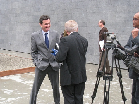 Benezra at press preview, being interviewed by Don Sanchez for ABC7, in the SFMoMA rooftop sculpture garden.