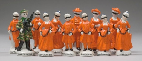 Penny Byrne Guantanamo Bay Souvenirs 2007, vintage figurines, metal chains, epoxy resin, plastic, re-touching medium, powder pigments, 14 x 32 x 10 cm.