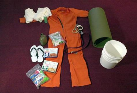 The standard issue of clothing, sleeping mat, food, sandles, canteen, soap, and buckets for detainees of Camp X-Ray is pictured in Camp X-Ray at the U.S. Navy Base at Guantanamo Bay, Cuba, on Wednesday, Feb. 20, 2002. Tomas van Houtryve/AP Photo