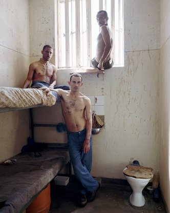 """Timmy (center), with Peter (left) and Frederick, Pollsmoor Maximum Security Prison, South Africa (c-type print, 12"""" x 16"""", 2003)"""