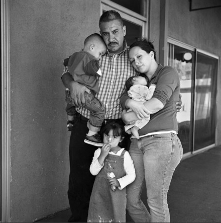 "© Joseph Rodriguez. ""Jorge Carbajal, 41 years old comes to Walden House for parenting classes and to help his wife Elizabeth and their kids. Here they are all together for their first family portrait in years. He quit his job with the airline KLM which had him traveling all over the world. Jorge says, ""I had to help my wife who has a drug addiction problem and I did not want to see my kids wind up in the system."" He is a rare individual as he was the only regular father/husband that I got to know who came regularly to meetings."" Joseph Rodriguez"
