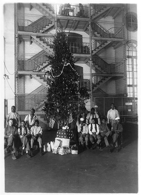 Christmas tree at the District Jail, Washington, D.C. and some of the prisoners (circa 1909-1932). National Photo Company Collection, Library of Congress. # LOT 12342-9