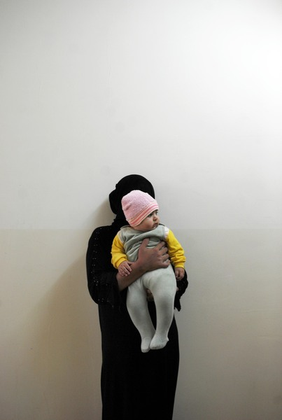 This woman was imprisoned on 8 Feb. 2009. The child was born in prison; he is 6 months old. She, an Arab from Mosul, was arrested for prostitution. At the time of the photograph, she had been imprisoned for 18 months. © Julie Adnan