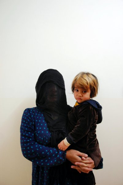 This female gypsy was sentenced to 15 months in prison for robbery. She would like her daughter be with her in prison. Her daughter was 1 year, 8 months old at the time of the portrait. © Julie Adnan