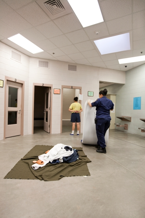 Female Inmate having her cell inspected. Challenge Program, El Paso, TX.