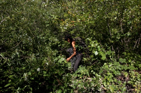 Lucia retrieving her stashed pack in the bushes. California. 2013.