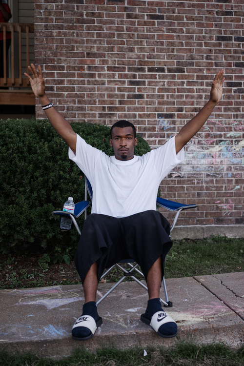 man-chair-hands-up
