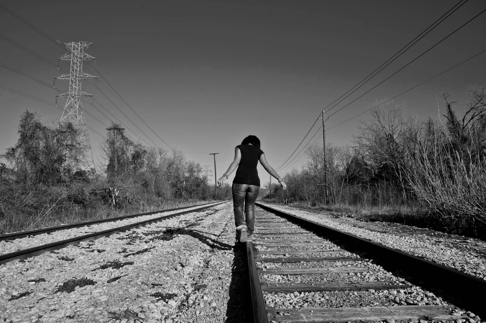 Chelsea Shorts walks along the railroad tracks near her home in East Austin.