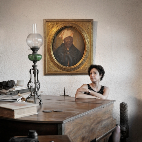 Lorraine Manuel Steed, with the portrait of her ancestor, Martha Adelaide Modeste, an African woman, City Pietonville