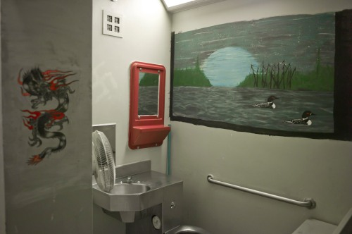 double sized cell with mural,  occupied by inmate incarcerated for 26 years