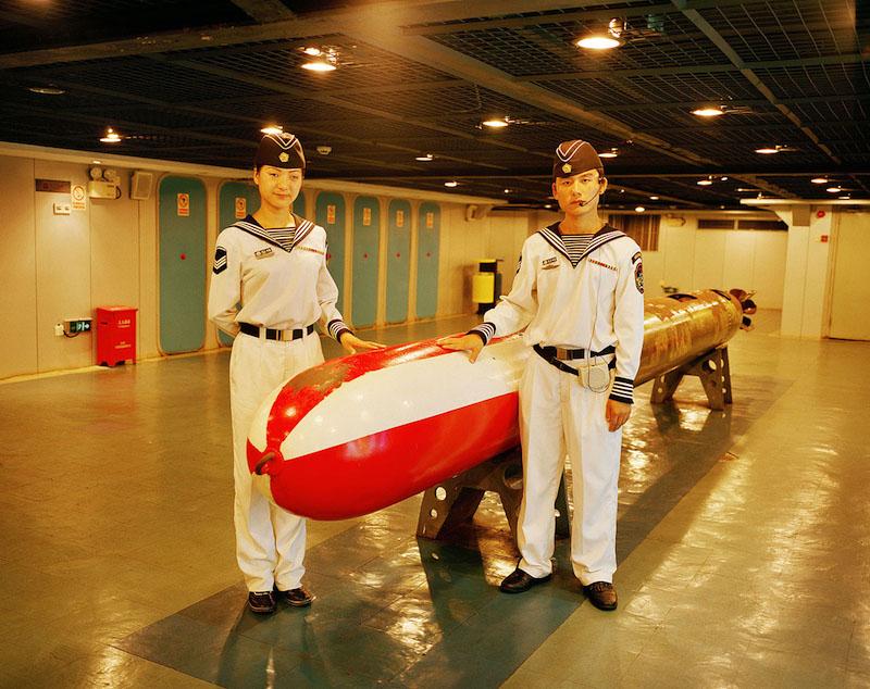 China, Shenzhen; Empoyees with Torpedo on the Themepark