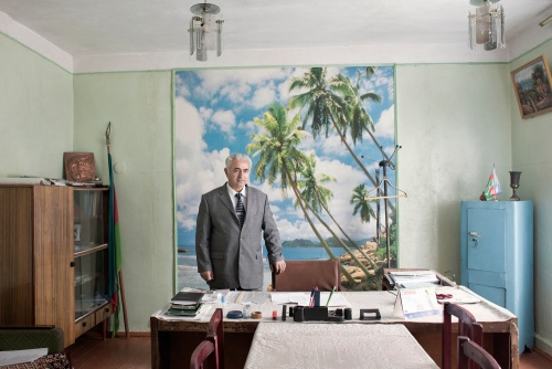 Official in his office. 2010 An official of Narimanabad village in his office. Azerbaijan. 2010
