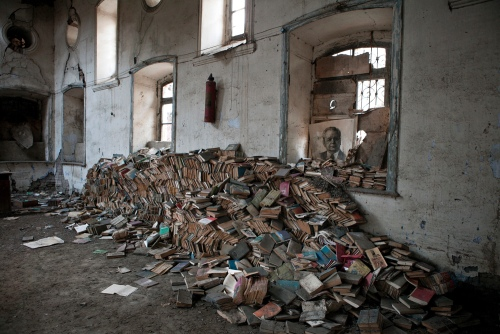 Untitled (Quba). 2011 Soviet era books are collected to trash in a former library in Quba. The alphabet in the country was changed from Cyrillic to Turkish after the independence and history of the country is now being re-writen, thus most of Soviet books became not needed. Azerbaijan. 2011